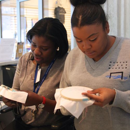 Even the HRM Employees Can't Resist Trying Rap Embroidery | Free Classes Spring 2015 at the Hudson River Museum in Yonkers, NY taught by textile artist Sarah Divi | SarahDivi.com